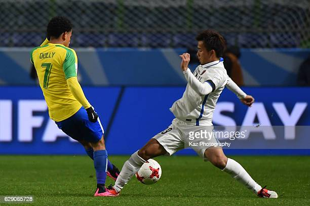 Gen Shoji of Kashima Antlers challenges Keagan Dolly of Mamelodi Sundownsduring the FIFA World Cup Quarter Final match between Mamelodi Sundowns and...