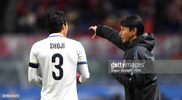 Gen Shoji of Kashima Antlers speaks to Masatada Ishii Coach of Kashima Antlers during the FIFA Club World Cup Semi Final match between Atletico...