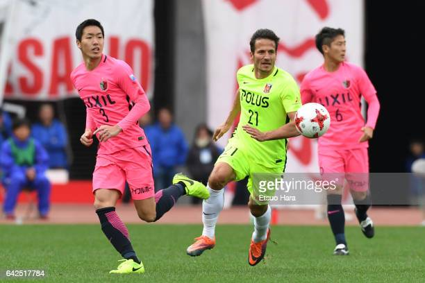 Gen Shoji#3 of Kashima Antlers and Zlatan Ljubijankic#21 of Urawa Red Diamonds compete for the ball during the Xerox Super Cup match between Kashima...