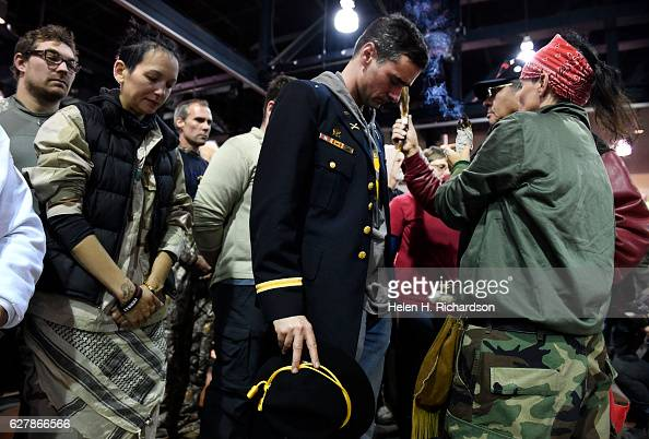 Gen Wesley Clark Jr middle and other veterans receive a blessing of sage during an emotional forgiveness ceremony at the Four Prairie Knights Casino...