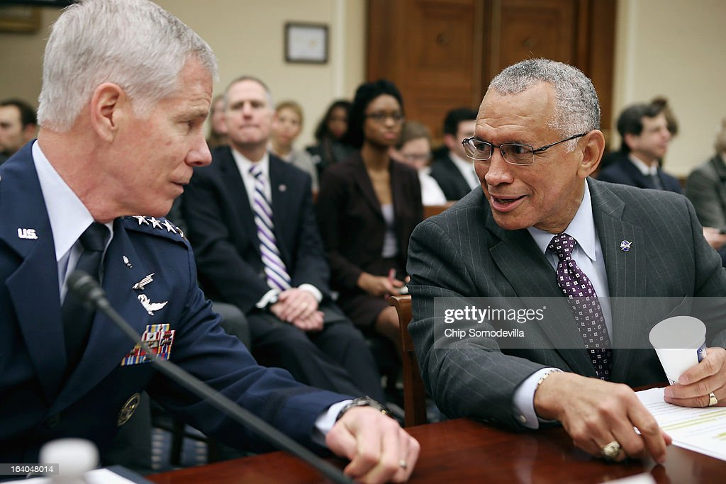 Gen. William Shelton (L), head of the U.S. Air Force Space Command, and NASA Administrator Charles Bolden Jr. talk before testifying to the House Science, Space and Technology Committee in the Rayburn House Office Building on Capitol Hill March 19, 2013 in Washington, DC. The committee asked government and military experts about efforts to track and mitigate asteroids, meteors and other 'near-Earth objects.'