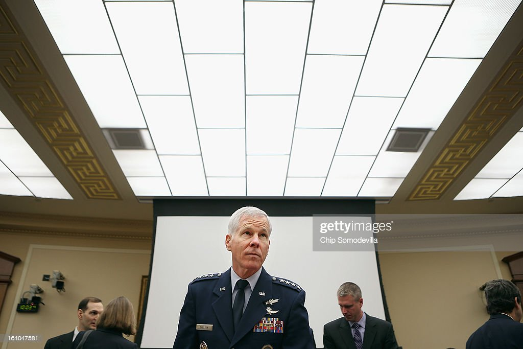 Gen William Shelton head of the US Air Force Space Command prepares to testify before the House Science Space and Technology Committee in the Rayburn...