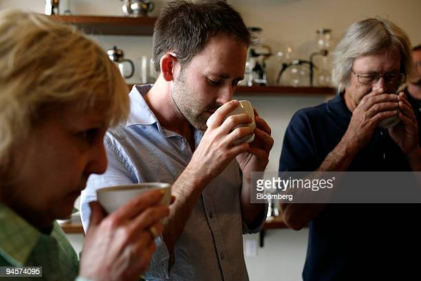 Gena Stutzman Tom Stutzman Jr and his father Tom Stutzman Sr take a breath of recently ground coffee at a cupping of fine coffees at Stumptown Coffee...