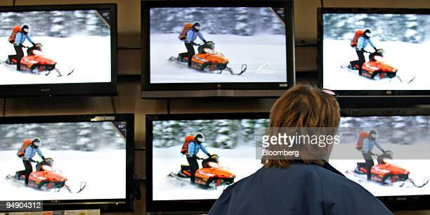 Gena Thompson looks at a wall display of High Definition Television sets at a Best Buy store in in Marysville Ohio US on Friday Jan 25 2008 Best Buy...