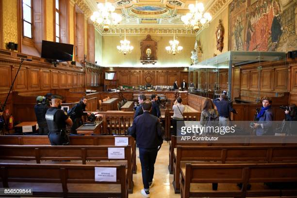 A gendarme looks on as journalists stand in the courtroom on October 2 2017 at Paris courthouse before the opening of the trial of Abdelkader Merah...