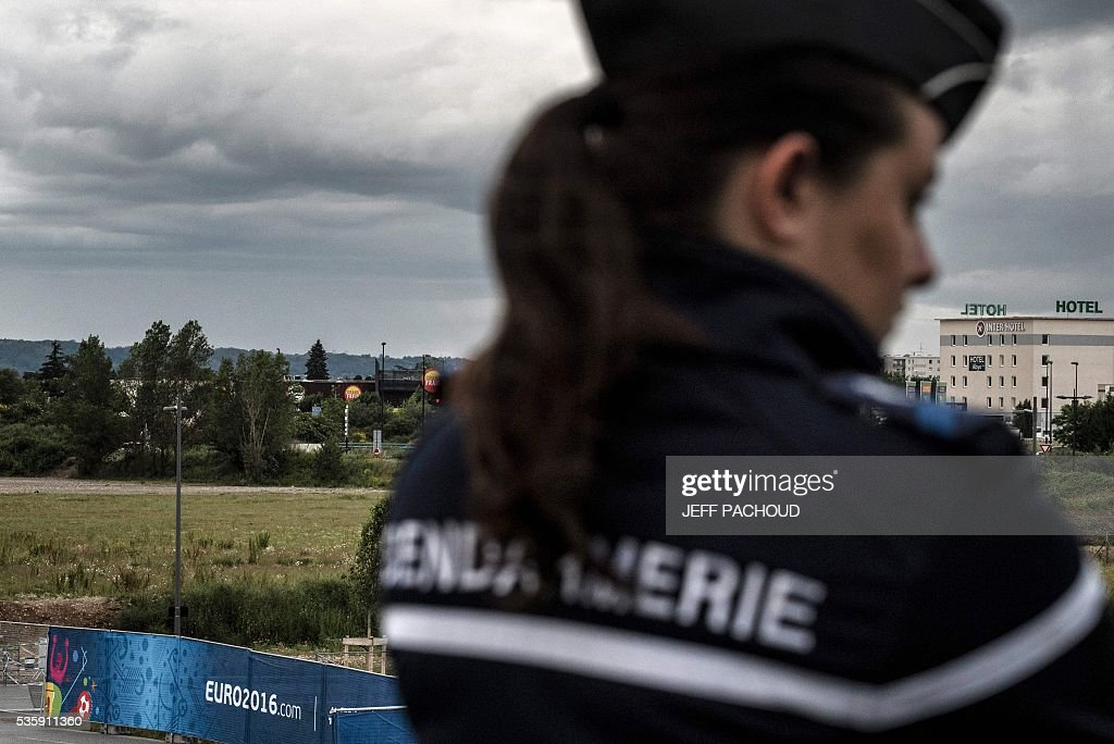 A gendarme takes part in a mock suicide attack exercise as part of security measures for the upcoming Euro 2016 football championship, at the Parc Olympique Lyonnais stadium in Decines-Charpieu, near Lyon, central-eastern France, on May 30, 2016. / AFP / JEFF