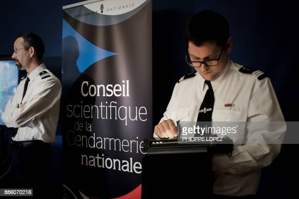 A gendarme uses a new computer equipment enabling authorities to detect the various identification parameters of a car according to to the vehicle...