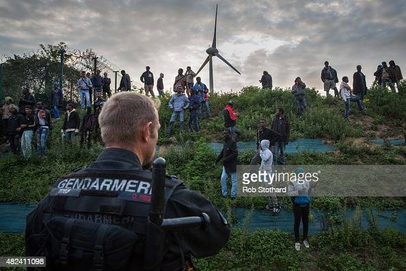 Gendarmerie attempt to prevent people from entering the Eurotunnel terminal in Coquelles on July 30 2015 in Calais France Hundreds of migrants are...