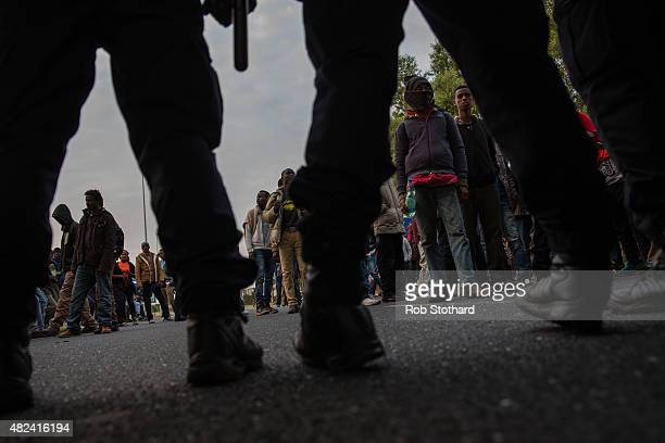 Gendarmerie block a road leading to the Eurotunnel terminal in Coquelles on July 30 2015 in Calais France Hundreds of migrants are continuing to...