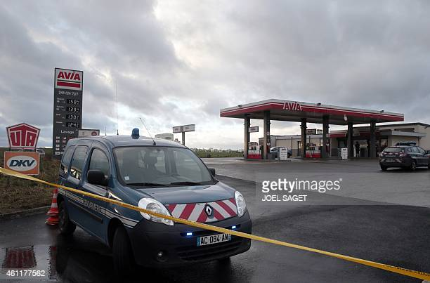 A Gendarmerie car is parked at an Avia gas station in VillersCotterets northeast of Paris on January 8 where the two armed suspects from the attack...