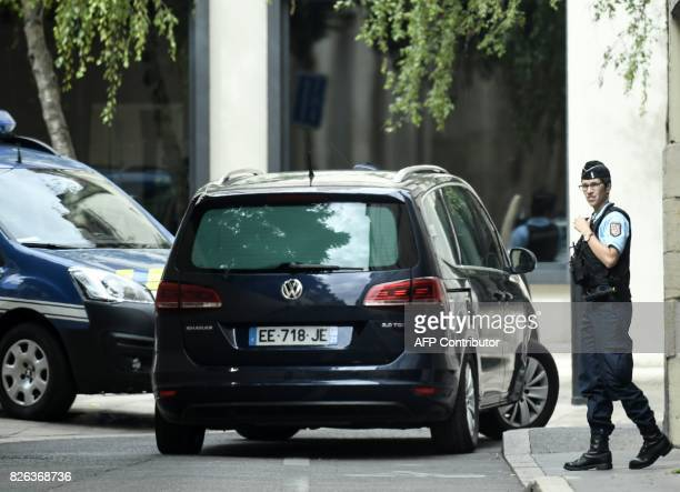 A gendarmerie car thought to transport Murielle Bolle a key witness in the Gregory case leaves the Court of Appeal in Dijon on August 4 2017 after...