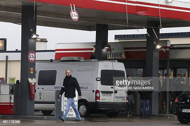 A Gendarmerie criminal identification van is parked in front of an Avia gas station in VillersCotterets northeast of Paris on January 8 where the two...