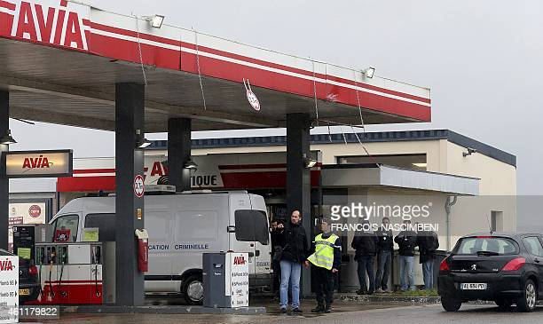 A Gendarmerie criminal identification van is parked in front of an Avia gas station in VillersCotterets northeast of Paris as gendarmes investigate...