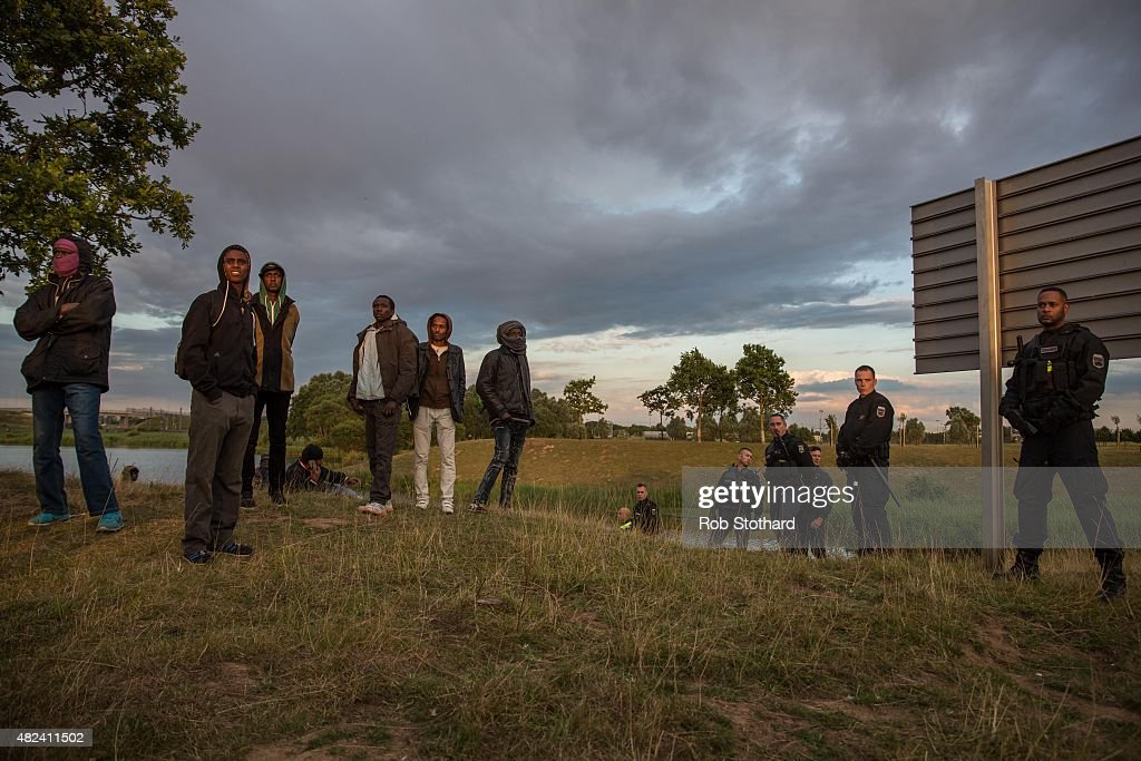 Gendarmerie guard a road leading to the Eurotunnel terminal in Coquelles on July 30 2015 in Calais France Hundreds of migrants are continuing to...