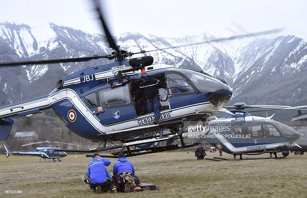 A gendarmerie helicopter gets ready to takeoff in a field where rescuers are headquartered on March 24 2015 in the southeastern French town of Seyne...