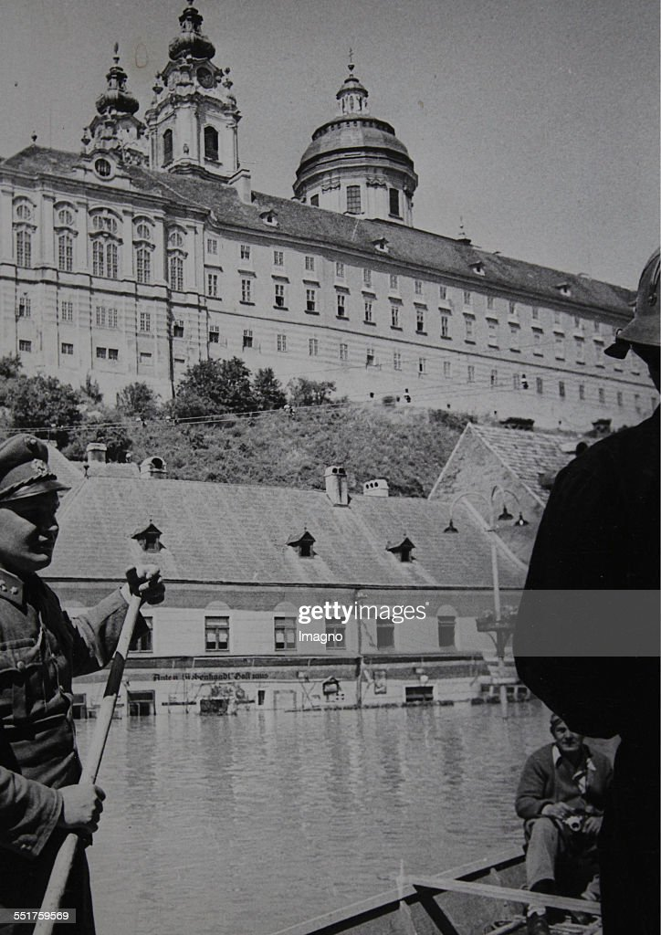 Gendarmerie in the flood area of Melk In the background the Benedictine monastery About 1955 Photograph by Votava / Vienna