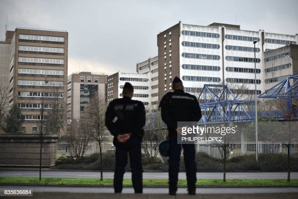 Gendarmerie members stand guard in Bobigny northern Paris on February 16 2017 after around 2000 people demonstrated on February 11 outside a...