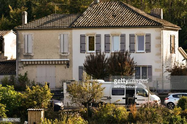 A Gendarmerie van is parked outside a house searched by police forces in Nerac southwestern France on September 20 2017 in the investigation of two...