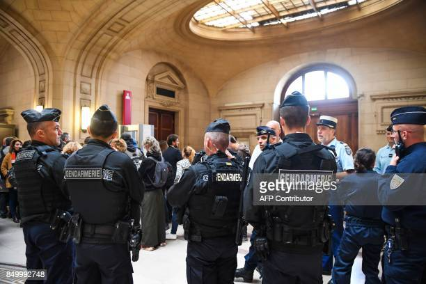 Gendarmes are pictured on September 20 2017 at the Paris courthouse within the start of the trial of nine people over an attack that turned a police...