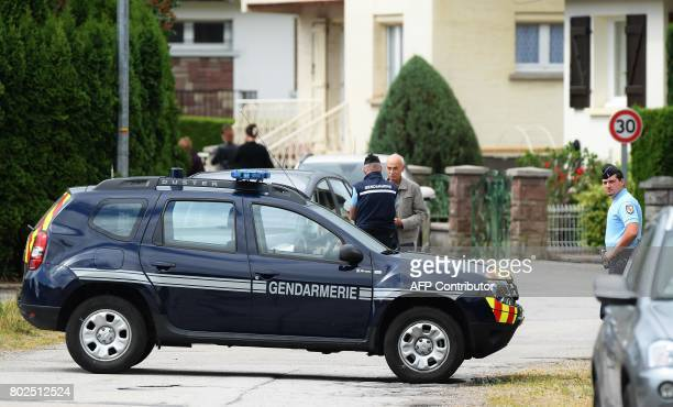 Gendarmes are seen near the residence of Murielle Bolle after she was arrested for questionning on June 28 2017 in Granges sur Vologne eastern France...
