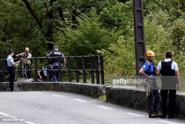 Gendarmes conduct a search for Maelys in Les Gorges de Chailles on September 6 2017 in Saint Beron eastern France as divers look in the Guiers river...