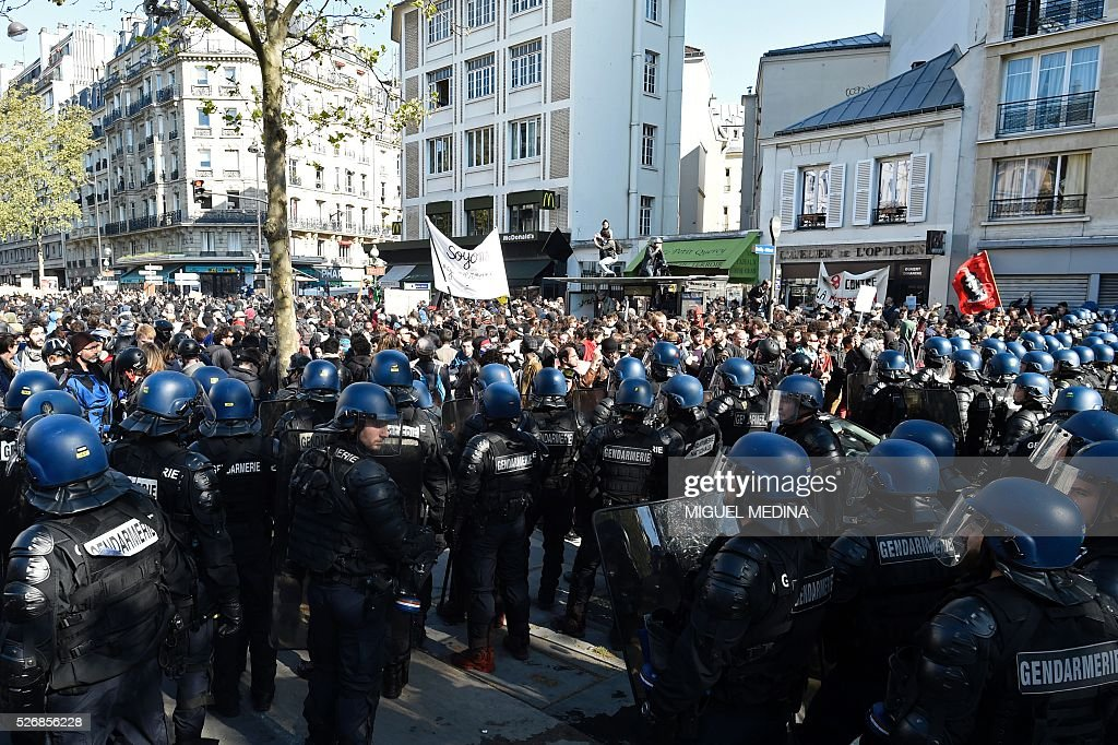 Gendarmes face protesters at a traditional May Day demonstration on May 1, 2016, in Paris.
