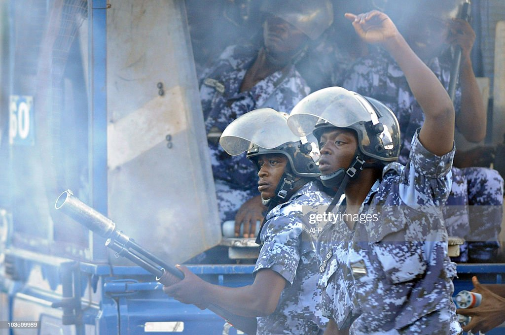 Gendarmes fire tear gas at opposition supporters gathered near the Gendarmerie Nationale in Lome on March 12, 2013 after opposition leaders Jean-Pierre Fabre and Abass Kaboua were called in for questioning in relation with the January fires that destroyed the Grande Marches in Lome and Kara. AFP PHOTO / Daniel Hayduk