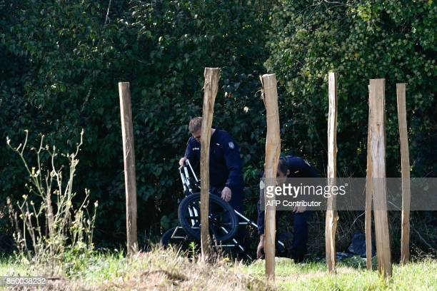 Gendarmes search the surroundings of a river and a house in Nerac southwestern France on September 20 2017 in the investigation of two missing...