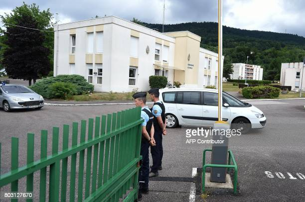 Gendarmes stand as Murielle Bolle is taken in a convoy leaving the Gendarmerie in SaintEtienneLesRemiremont eastern France on June 29 to be brought...