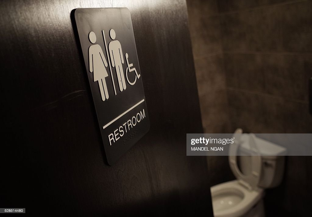 A gender neutral bathroom is seen at a coffee shop in Washington, DC, on May 5, 2016. A heated national debate over access to bathrooms by transgenders is sweeping the United States, with schools and businesses grappling with the issue that has become a hot topic in the presidential campaign. The so-called 'bathroom battle' erupted after North Carolina in March became the first US state to require transgender people to use restrooms in public buildings that match the sex on their birth certificate, rather than the gender by which they identify. Mississippi followed suit in April and a number of other conservative states and cities are mulling or have passed similar legislation. NGAN