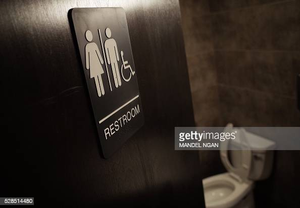 A gender neutral bathroom is seen at a coffee shop in Washington DC on May 5 2016 A heated national debate over access to bathrooms by transgenders...