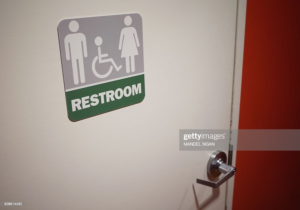 A gender neutral bathroom is seen at a restaurant in Washington DC on May 5 2016 A heated national debate over access to bathrooms by transgenders is...