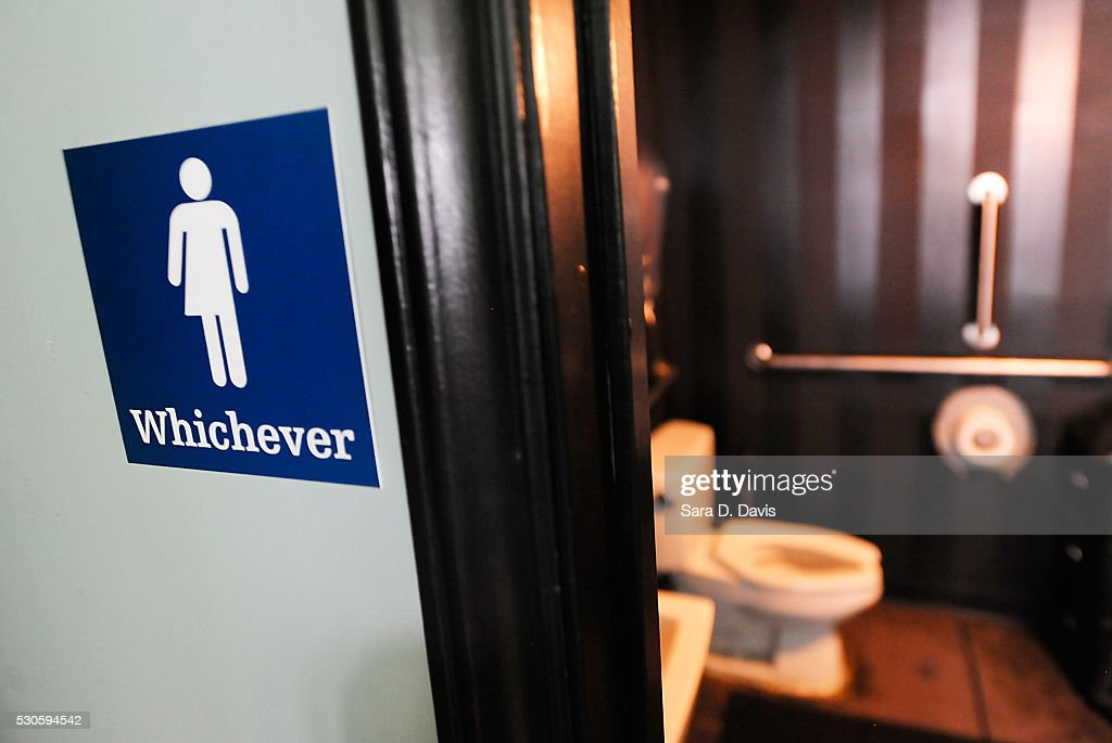 A gender neutral sign is posted outside a bathrooms at Oval Park Grill on May 11 2016 in Durham North Carolina Debate over transgender bathroom...