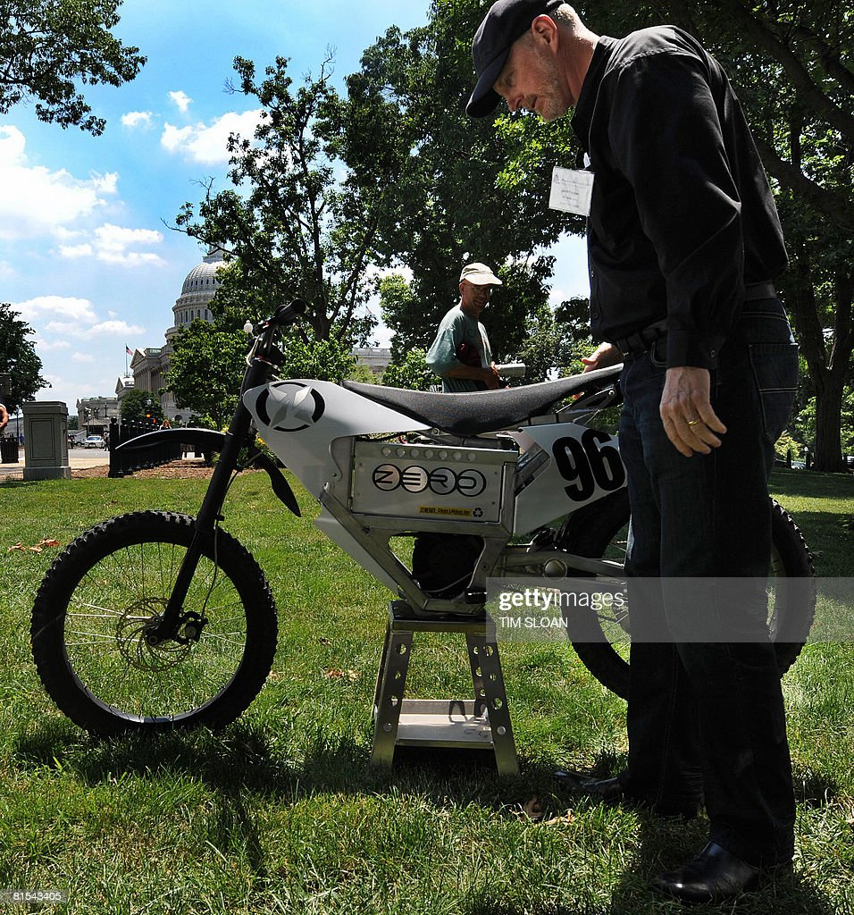 Gene Banman, CEO of Zero Motorcycles Inc., with his all electric prototype in a park near the US Capitol as part of a showcase of new automotive technologies that can help reduce our dependence on oil June 12, 2008 in Washington, DC. With oil and gas prices expected to remain near record highs in the near future, rapid technological innovations in the transportation sector are critically important to help end our nation?s addiction to oil and reduce global warming pollution. AFP PHOTO / TIM SLOAN