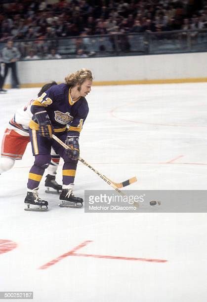 Gene Carr of the Los Angeles Kings skates with the puck during an NHL game against the New York Rangers circa 1974 at the Madison Square Garden in...