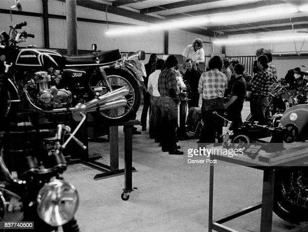 Gene Clifford staff dean at Cycle Institute of America and a veteran bike racer presides over typical class of young students in main training room...