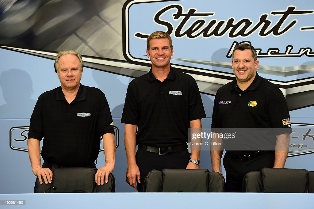 <a gi-track='captionPersonalityLinkClicked' href=/galleries/search?phrase=Gene+Haas&family=editorial&specificpeople=7243190 ng-click='$event.stopPropagation()'>Gene Haas</a>, co-owner of Stewart-Haas Racing, <a gi-track='captionPersonalityLinkClicked' href=/galleries/search?phrase=Clint+Bowyer&family=editorial&specificpeople=537951 ng-click='$event.stopPropagation()'>Clint Bowyer</a>, newest driver for Stewart-Haas Racing, and <a gi-track='captionPersonalityLinkClicked' href=/galleries/search?phrase=Tony+Stewart+-+Racerf%C3%B6rare&family=editorial&specificpeople=201686 ng-click='$event.stopPropagation()'>Tony Stewart</a>, driver of the #14 Stewart-Haas Racing Chevrolet and co-owner of Stewart-Haas Racing, pose for a photo opportunity after a press conference announcing the retirement of Stewart on September 30, 2015 in Kannapolis, North Carolina. Stewart has decided his 18th year in the NASCAR Sprint Cup Series will be his last. The three-time series champion will retire following the 2016 season, whereupon <a gi-track='captionPersonalityLinkClicked' href=/galleries/search?phrase=Clint+Bowyer&family=editorial&specificpeople=537951 ng-click='$event.stopPropagation()'>Clint Bowyer</a> will take the wheel of the No. 14 machine beginning in 2017.