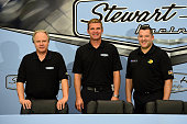 Gene Haas coowner of StewartHaas Racing Clint Bowyer newest driver for StewartHaas Racing and Tony Stewart driver of the StewartHaas Racing Chevrolet...