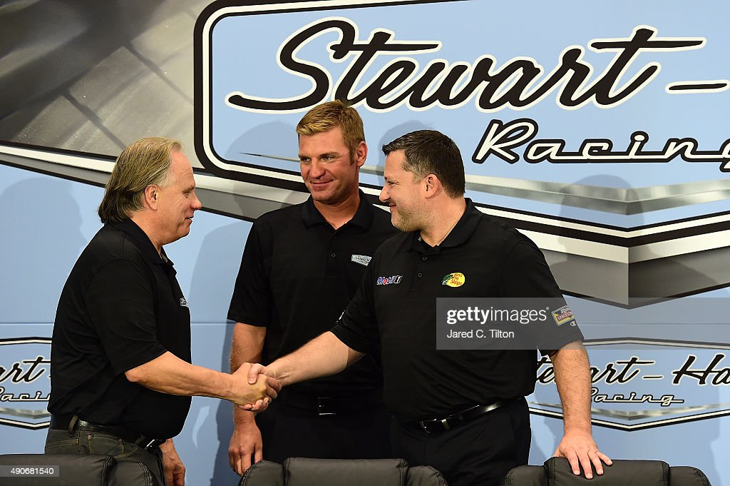 Gene Haas coowner of StewartHaas Racing shakes hands with Tony Stewart driver of the StewartHaas Racing Chevrolet and coowner of StewartHaas Racing...