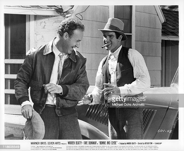Gene Hackman and Warren Beatty share a laugh in a scene from the film 'Bonnie and Clyde' 1967
