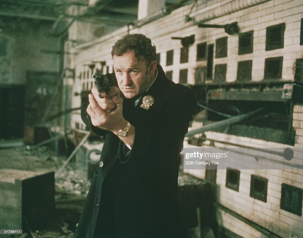 1971, Gene Hackman as Detective Jimmy 'Popeye' Doyle points his handgun in a still from the film 'The French Connection' directed by William Friedkin.