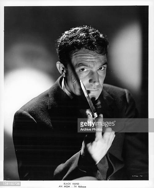Gene Kelly holding knife in a scene from the film 'Black Hand' 1950