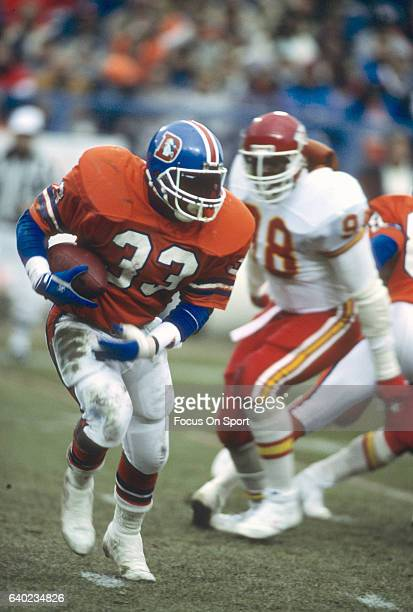 Gene Lang of the Denver Broncos carries the ball against the Kansas City Chiefs during an NFL football game November 16 1986 at Mile High Stadium in...
