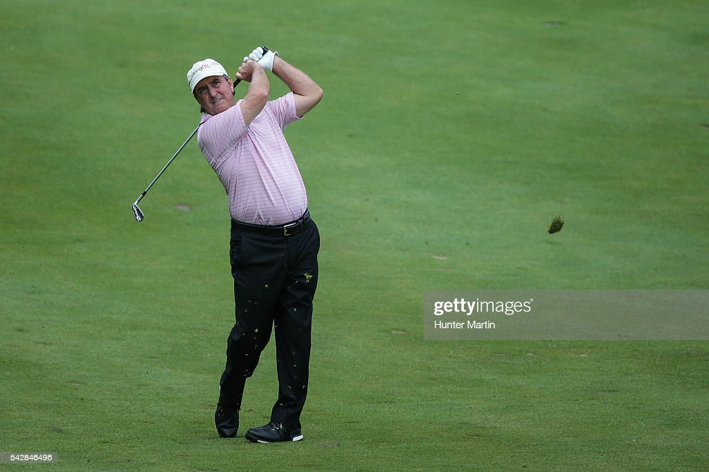<a gi-track='captionPersonalityLinkClicked' href=/galleries/search?phrase=Gene+Sauers&family=editorial&specificpeople=2617796 ng-click='$event.stopPropagation()'>Gene Sauers</a> hits his second shot on the 18th hole during the first round of the Champions Tour American Family Insurance Championship at University Ridge Golf Course on June 24, 2016 in Madison, Wisconsin.