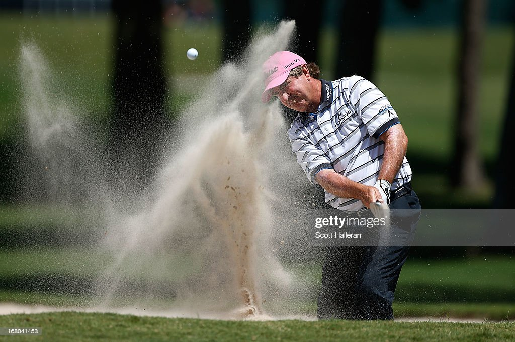 Gene Sauers plays a bunker shot on the tenth hole during the second round of the Insperity Championship at the Woodlands Country Club on May 4, 2013 in Woodlands, Texas.