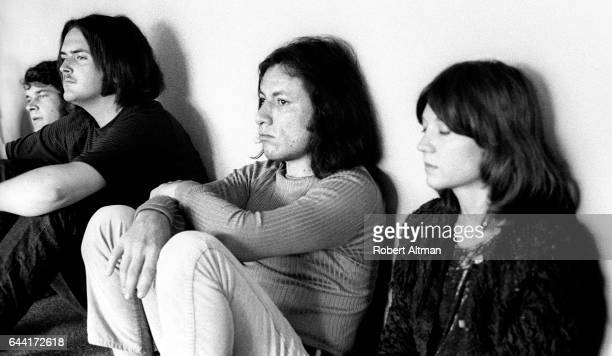 Gene Schoenfeld and a group of people sit against a wall during The Alternative Media Conference on June 1720 1970 at Goddard College in Plainfield...