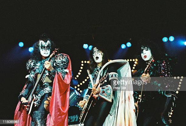 Gene Simmons Ace Frehley and Paul Stanley of American glam metal band Kiss perform on stage at Wembley Arena on their 'Unmasked' concert tour on...