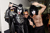 Gene Simmons and Paul Stanley of KISS pose with designer John Varvatos at Fashion Rocks 2014 presented by Three Lions Entertainment at the Barclays...