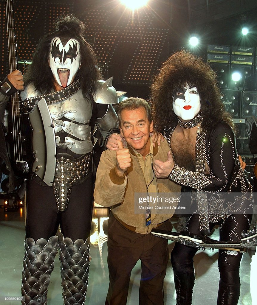 <a gi-track='captionPersonalityLinkClicked' href=/galleries/search?phrase=Gene+Simmons&family=editorial&specificpeople=138593 ng-click='$event.stopPropagation()'>Gene Simmons</a> and Paul Stanley of KISS with <a gi-track='captionPersonalityLinkClicked' href=/galleries/search?phrase=Dick+Clark&family=editorial&specificpeople=213041 ng-click='$event.stopPropagation()'>Dick Clark</a> on stage at the taping of the 'American Bandstand's 50th ... A Celebration!', to air on ABC TV on May 3, 2002.