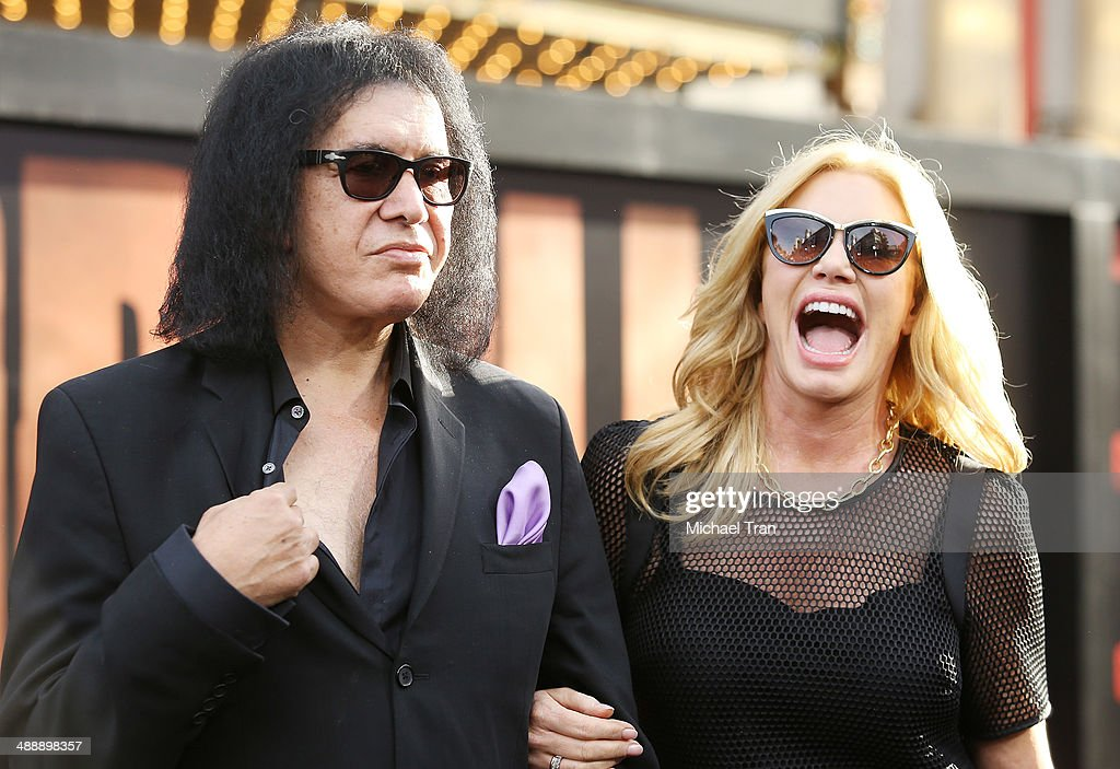 Gene Simmons and Shannon Tweed arrive at the Los Angeles premiere of 'Godzilla' held at Dolby Theatre on May 8 2014 in Hollywood California